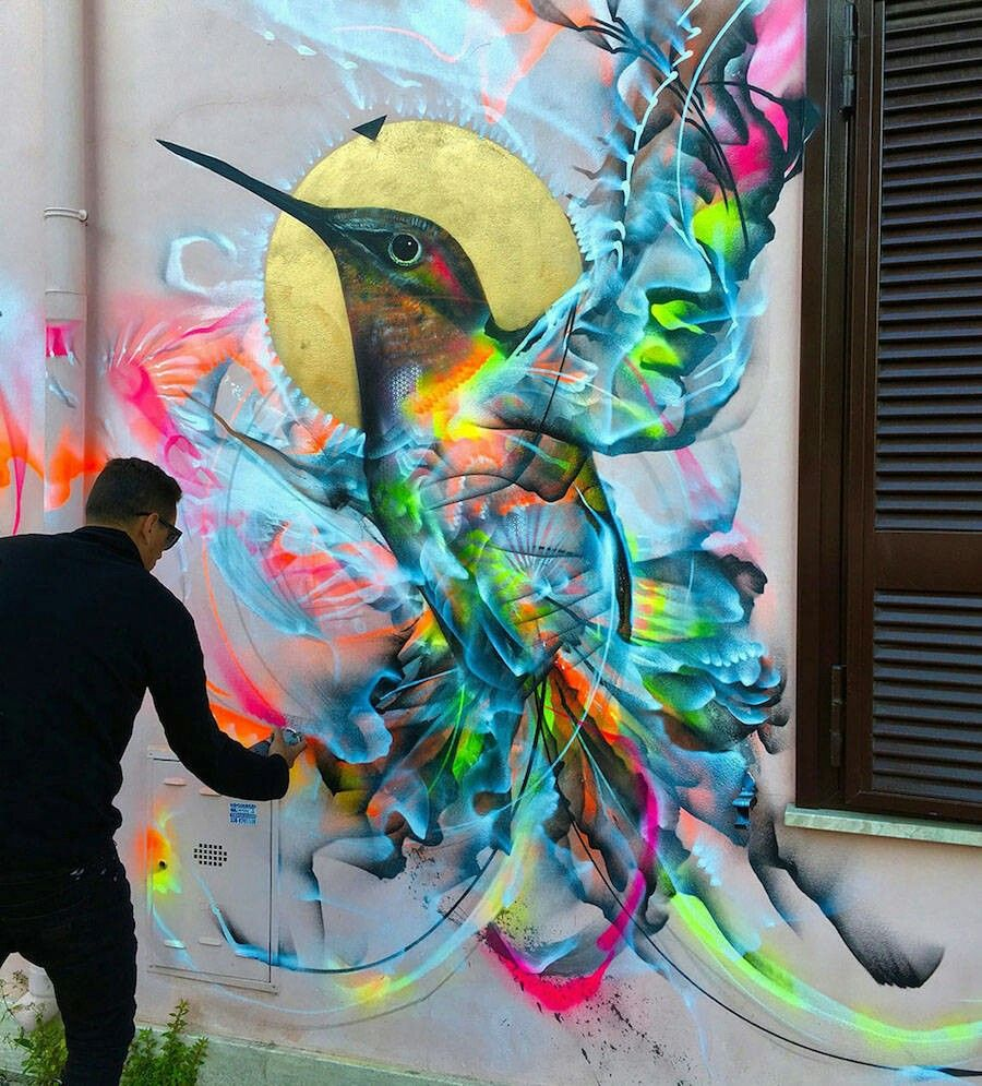 Street art this hummingbird is amazing the only true part is the head and beak all the rest is just suggested and yet you see a beautiful hummingbird