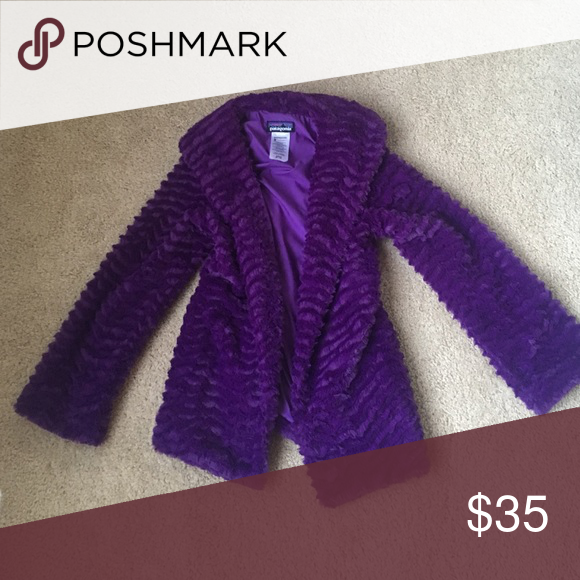 Barely used jacket that is very warm and stylish! The purple jacket is warm and vey soft. It is perfect for staying cozy on a cold day! Patagonia Jackets & Coats