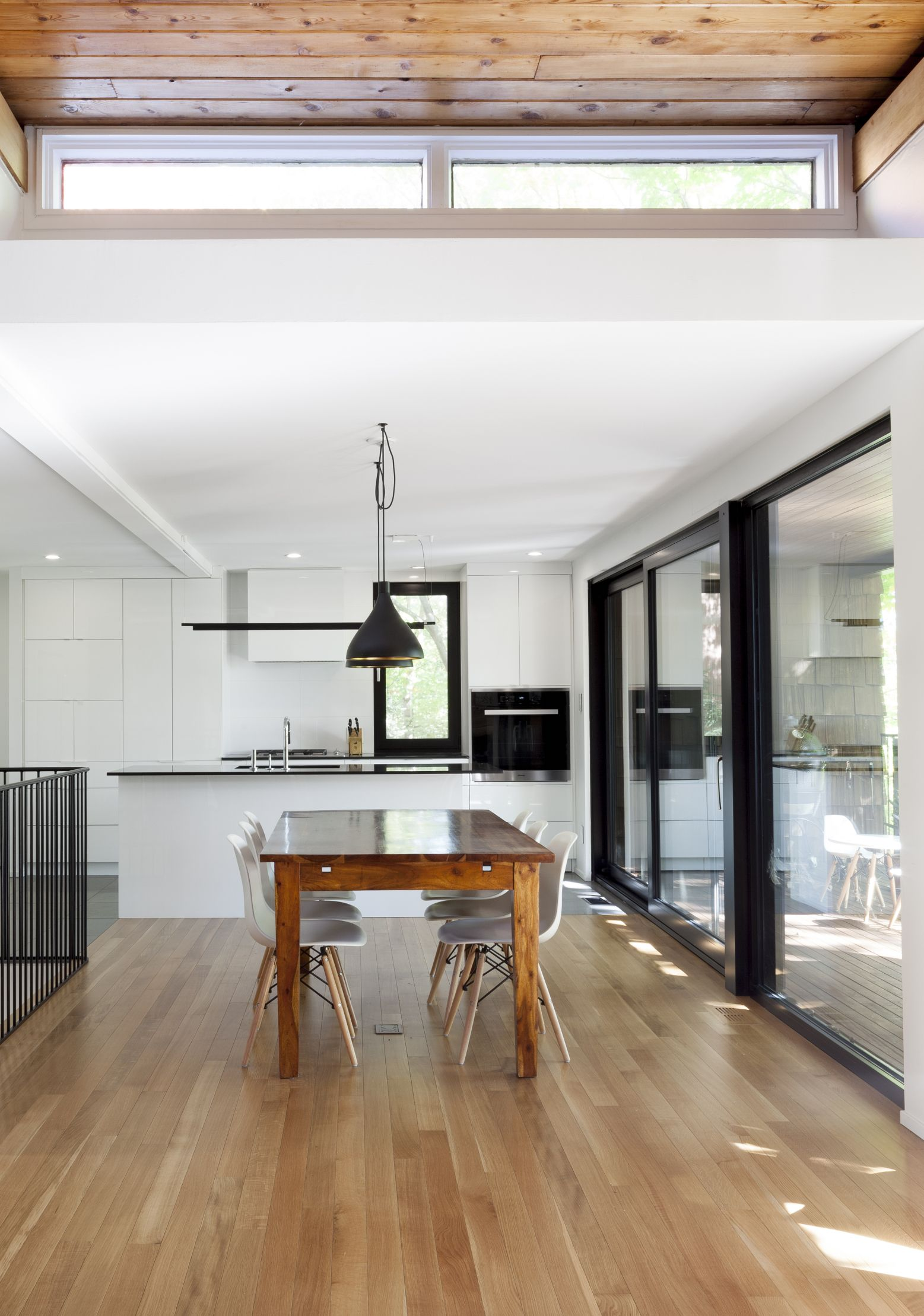 Dining room and kitchen interior design, white walls, wood floors ...