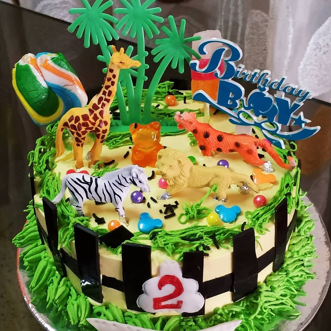 "Reena Khalkho on Instagram: ""Kid's favourite😍😚zoo 🐘🐼theme eggless butterscotch birthday cake🎂🎉🎁 🎂🍰for a two years old boy 👦 eggless #themecakes #party…"""