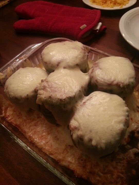 Stuffed pepper's covered with mozzarella cheese. 