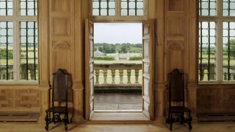 View of the Great Room at Lodge Park showing open doors and view of the park.