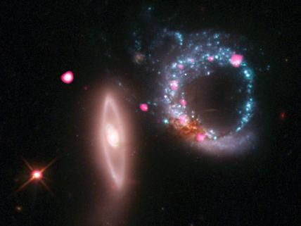 Just in time for Valentine's Day comes a new image of a ring -- not of jewels -- but of black holes. This composite image of Arp 147, a pair of interacting galaxies located about 430 million light years from Earth, shows X-rays from the NASA's Chandra X-ray Observatory (pink) and optical data from the Hubble Space Telescope (red, green, blue) produced by the Space Telescope Science Institute, or STScI.