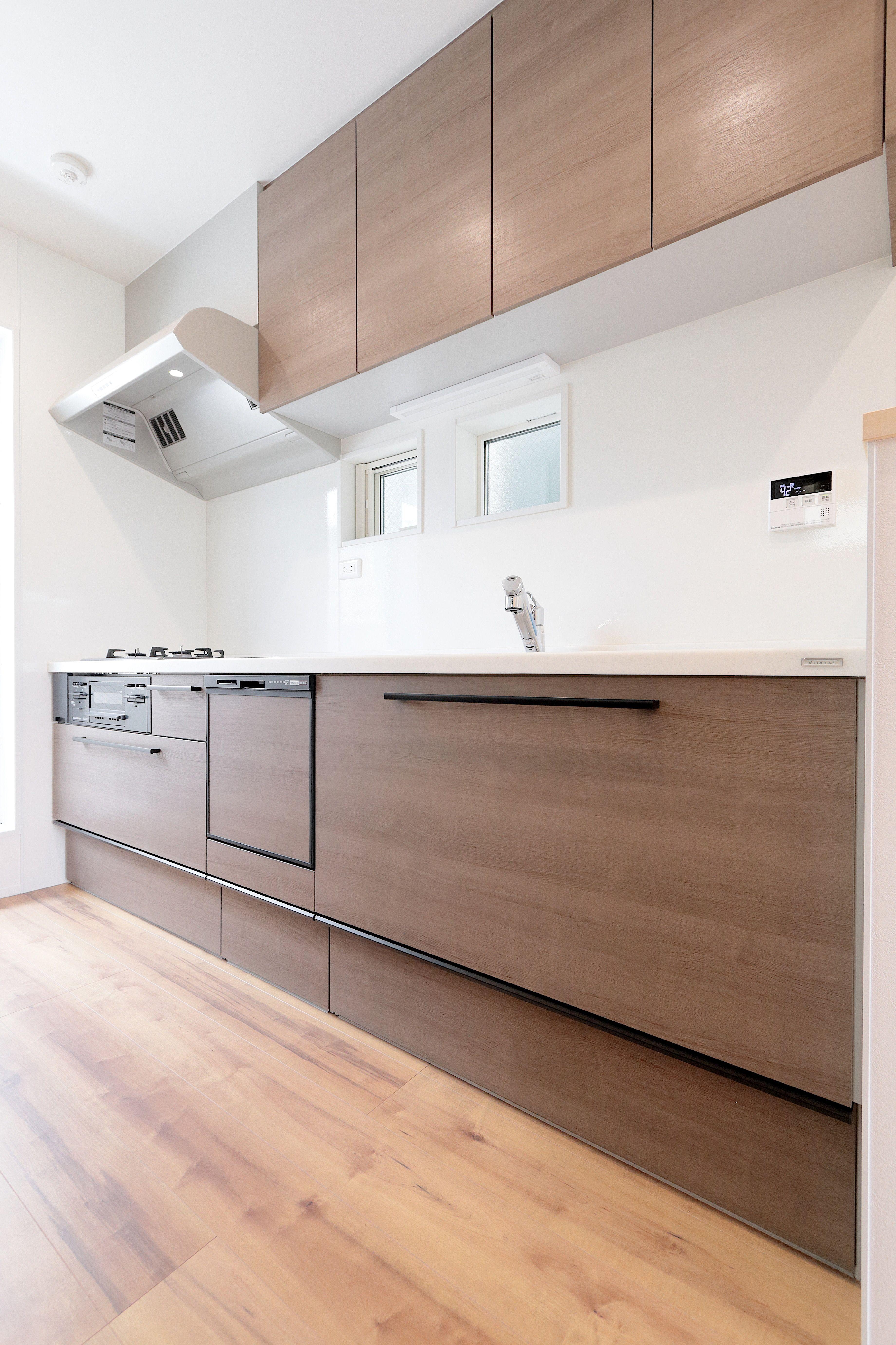 ジェネシスの施工事例 おしゃれで温かみのある充実収納の しまう 家 キッチンデザイン システムキッチン 注文住宅