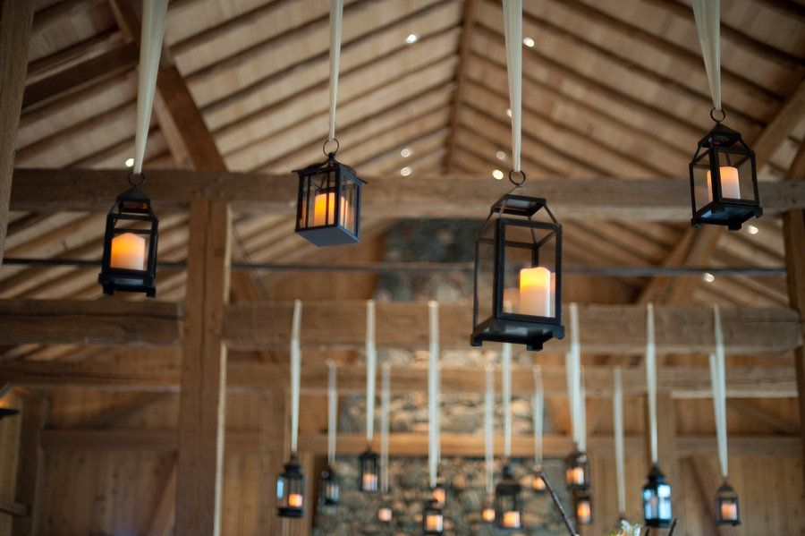 Lanterns Hanging From Ceiling At Rustic Indoor Wedding Reception | Photo:  Paigeelizabeth.net
