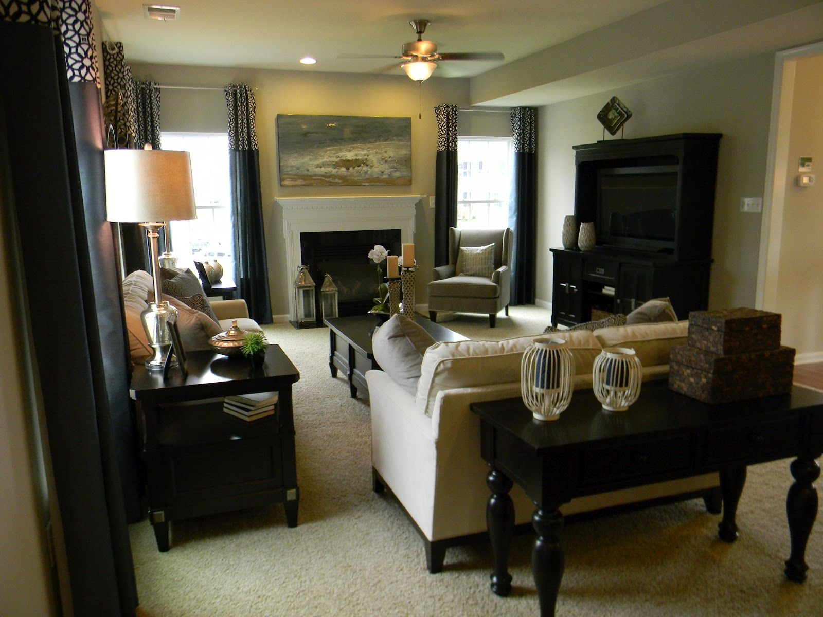 Model Home Curtains living room setup. split level furniture placement with fireplace