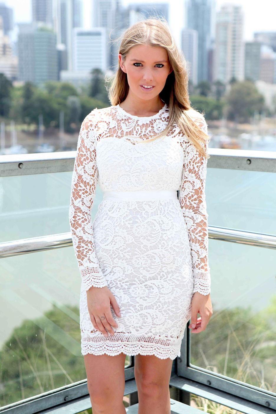 Long sleeve short white lace dress.