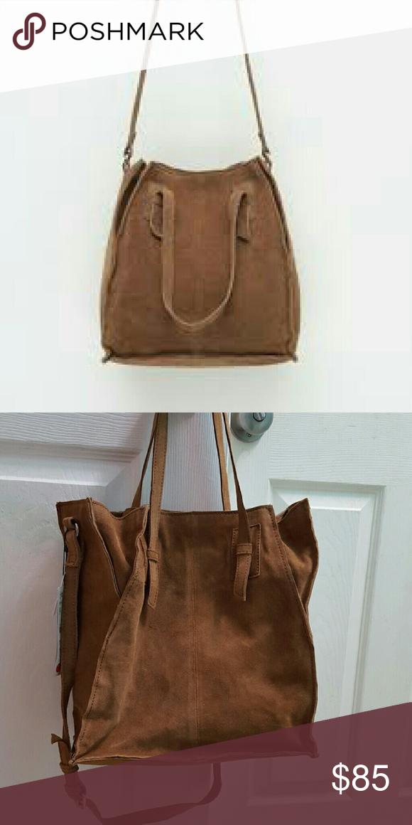 be2c2787a4 Leather tote. Handle and cross-body strap. Lining. Magnet closure. Height x  Width x Depth approx.  30 x 28 x 13 cm.