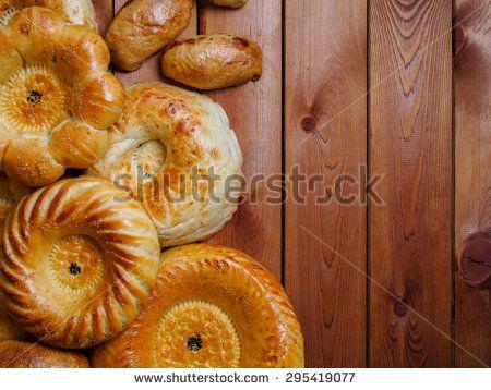 Uzbek national bread on wooden table - stock photo