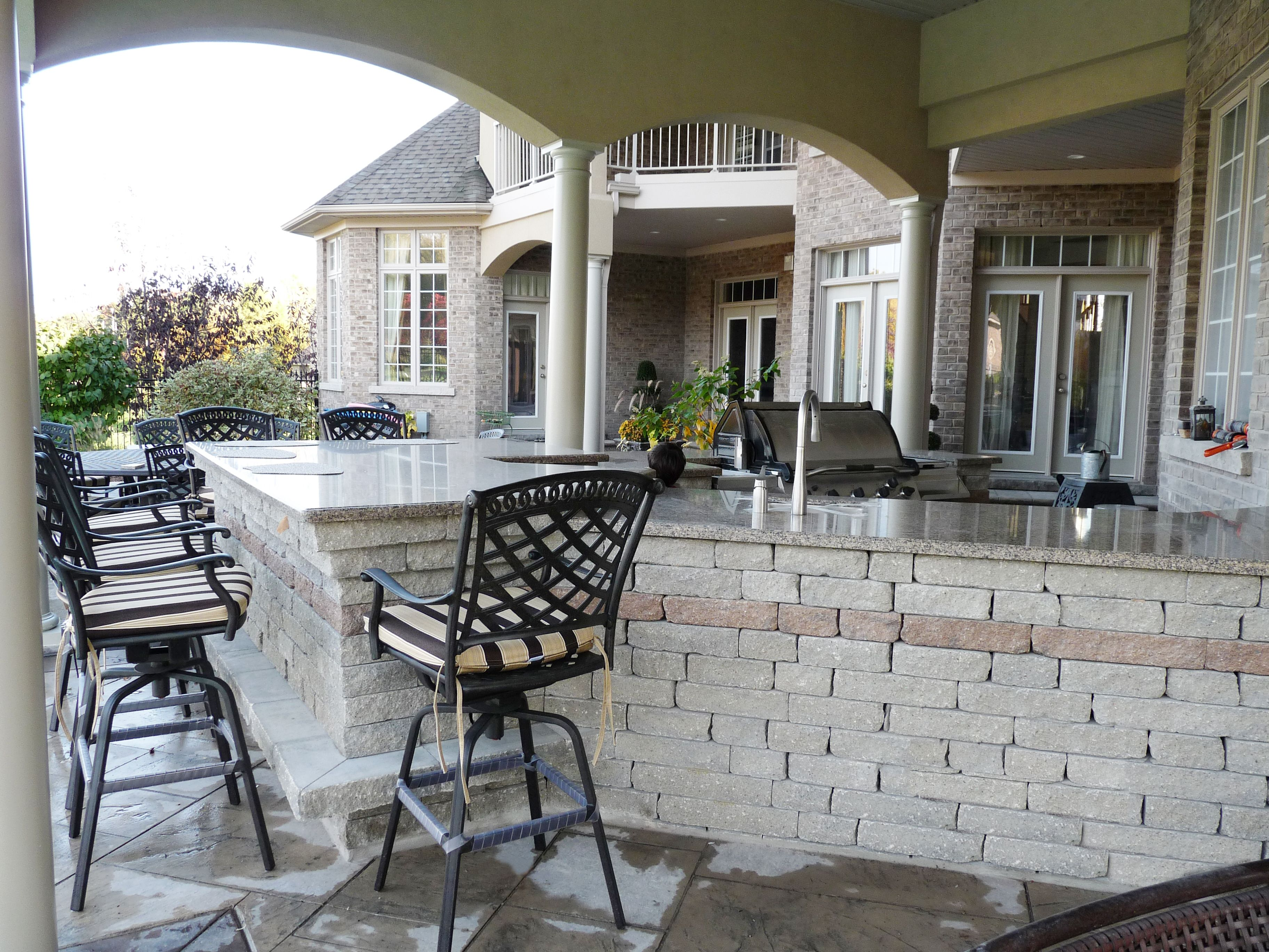 Photo by Dennis Miller. Outdoor kitchen with precast concrete base and granite countertop.