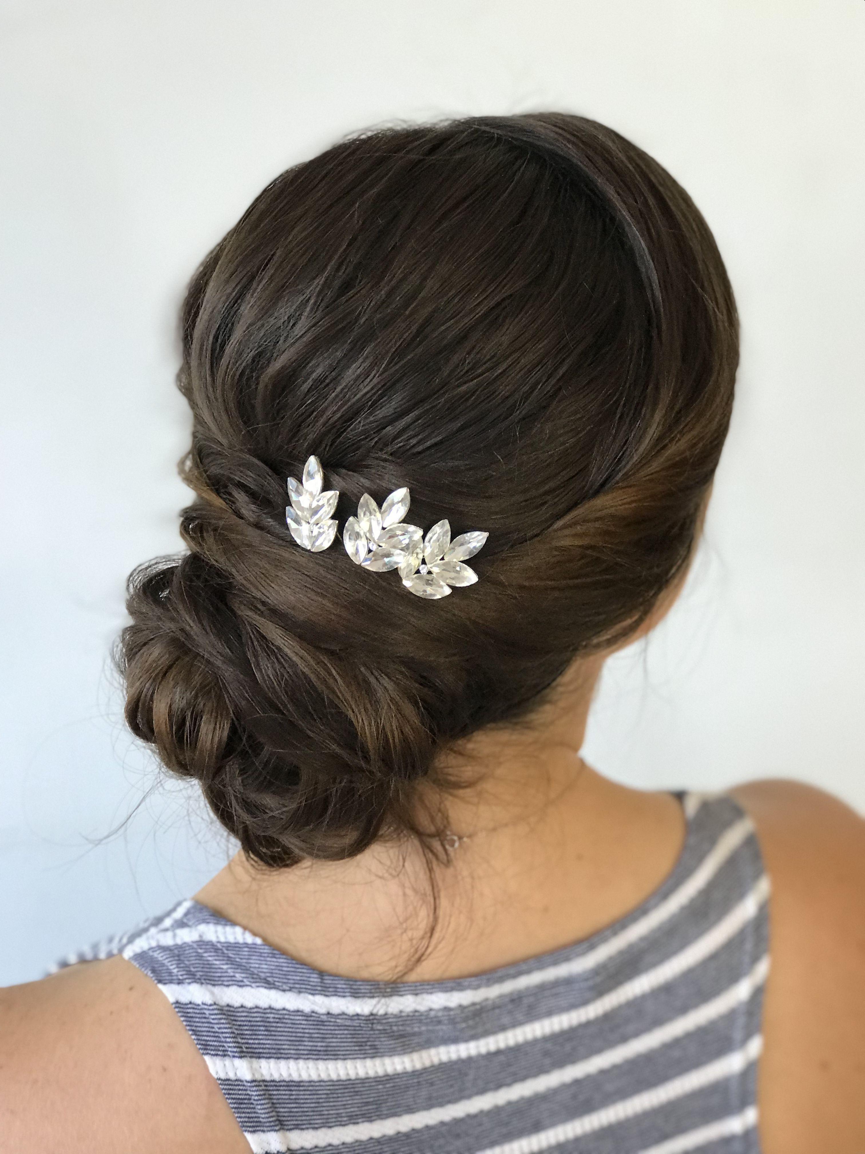 Sleek twists with a low bun hair pins in studio (FBJ