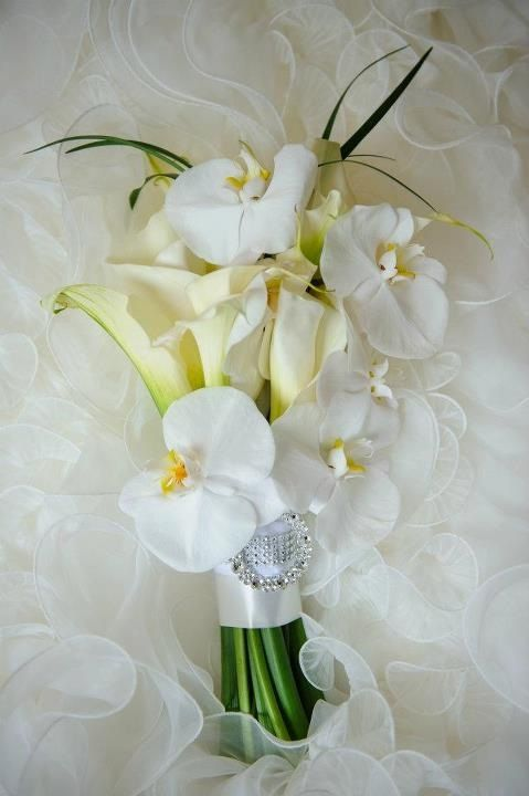 All-white bouquet with orchids and lilies.