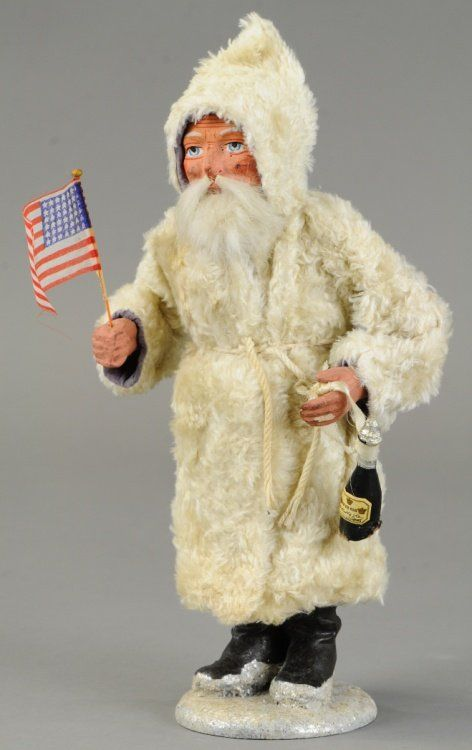 """A furry white robe Santa with composition hands, feet and head with rabbit fur beard, standing on mica flecked snow base. 11"""" h., $1,300"""