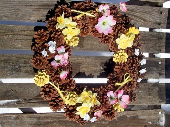 Spring!  Pine Cone Wreath With Silk Flowers.  Daffodils, apple blossoms. www.etsy.com/shop/NaturesCraftSupply
