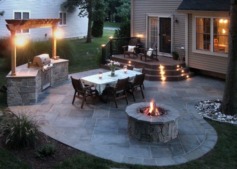 Small Deck Transition To Patio With Lights On Steps