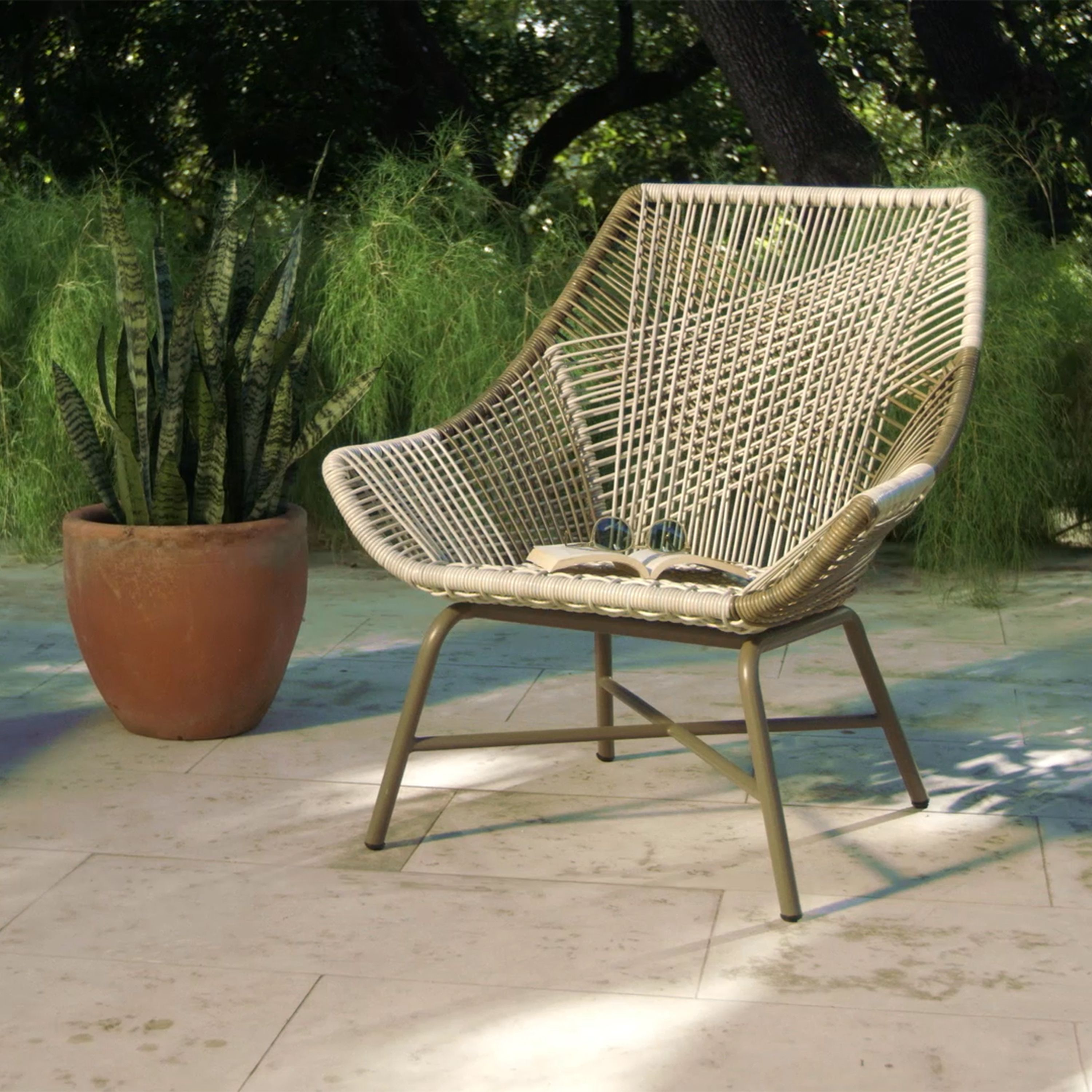 Standing on iron legs, our lounge chair is crafted of