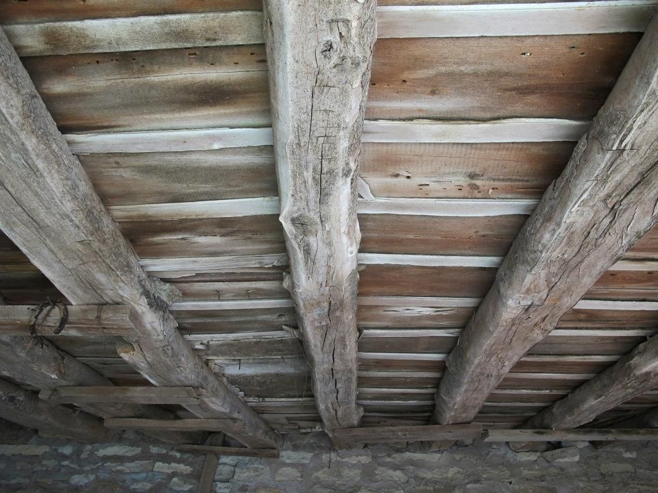Roof beams from old limestone stable.  Chase County, Kansas.  photo by susan pogany