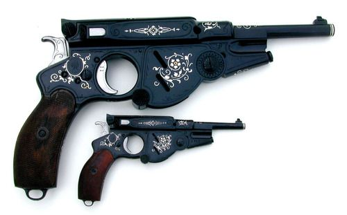 Beautifully Decorated Bergmann Pistol and it's half size...