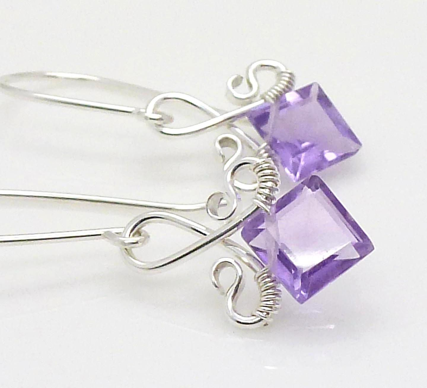 XXX Purple amethyst earrings Sterling silver Wire wrapped Amethyst dangle earrings. $55.00, via Etsy.