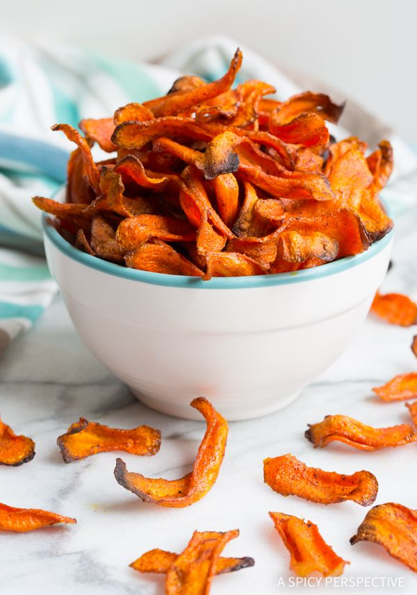 Healthy Baked Carrot Chips Recipe - Get your crunchy chip-fix without ruining your diet! These gluten free, low fat snacks are easy to make and easy to love