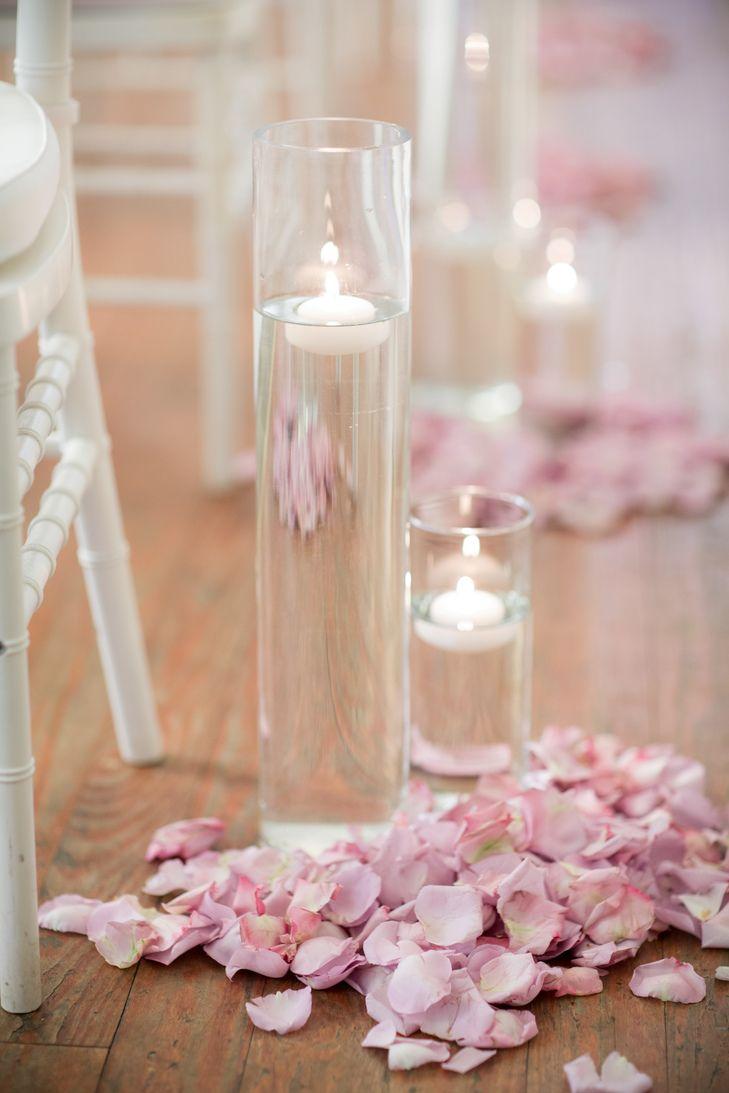 Blush rose petal floating candle wedding ceremony aisle