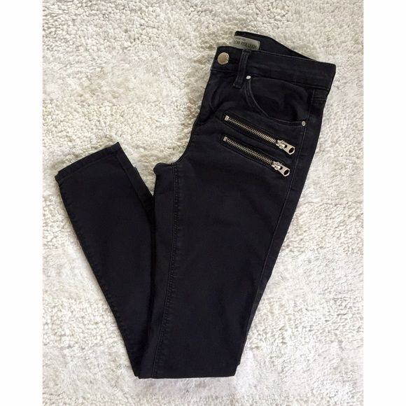 Black Skinny Jeans Distressed black. Silver zippers. Ankle fit. Fits more like a 0/24 Topshop Jeans Ankle & Cropped
