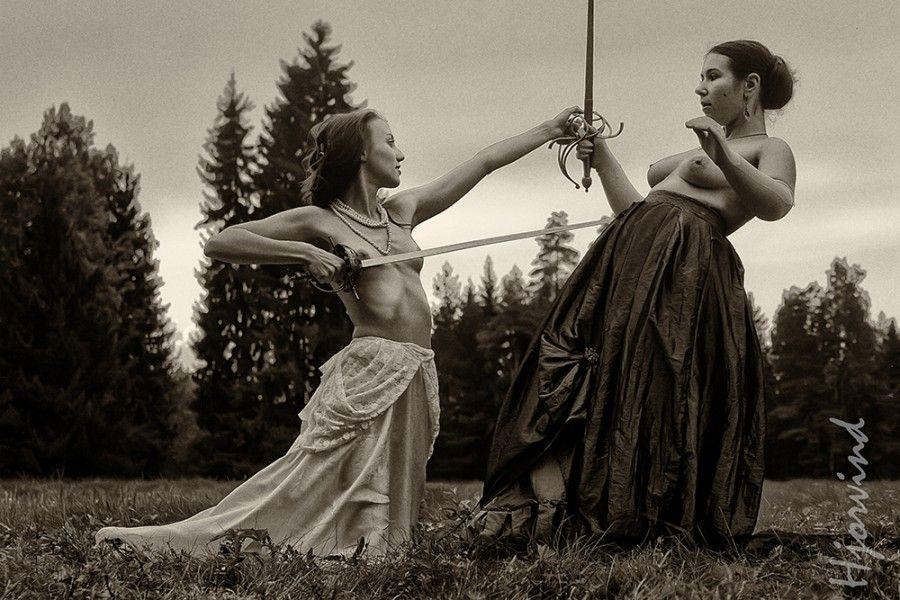 Nude girls sword fighting