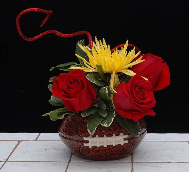 A Variety Of Flower Arrangements Created In Football Container For The Sports Enthusiast High School College Player Or Superbowl Parties From