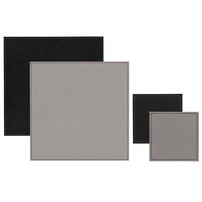 iStyle Reversible Grey and Black Placemats and Coasters Pack of four handmade, reversible placemats and coasters from iStyle My HomeGrey on one side and black on the reverseA simple, faux leather design with stitched borders, these placemats and coasters add a contemporary feature to any homeHeat resistant up to 90 degrees CEach coaster measures 10cm x 10cmEach placemat measures 25cm x 25cmWipe cleanEach sold separately