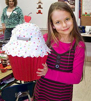 """""""Every year, I make a special collection container for my daughter's classroom valentines. One year, she asked if we could create a giant cupcake. For the liner, I folded card stock into accordion pleats and glued it to the outside of a flowerpot. For the cupcake itself, I hot-glued faux rose petals to the outside of a hat and glued on paper-heart sprinkles. Finally, I cut an opening in the top so that kids could insert their valentines. It was a hit at the party!""""   Pam Earls  Conway, MO"""