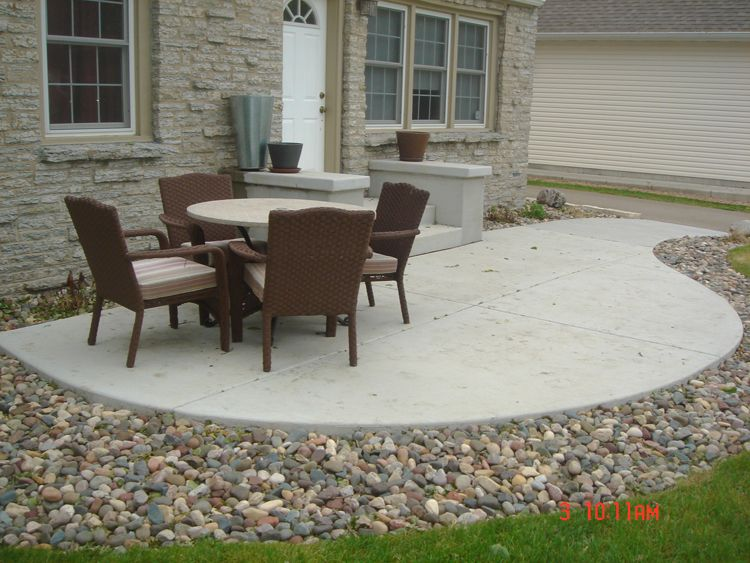 Love The Stone Surrounding The Concrete Patio