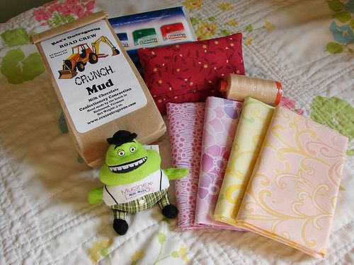 What a sweetie she is - she sent me a lovely package!  Four fq's of gorgeous spring-y fabric, some Aurifil thread