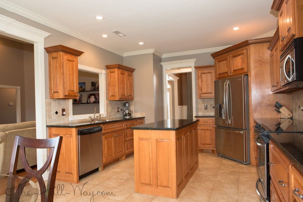 Kitchen w/ Maple Cabinets with Cherry Stain and Mocha ... on What Color Backsplash With Maple Cabinets  id=93334