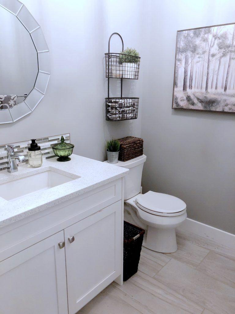 Powder Room Bathroom With White Cabinets Quartz Counter Top