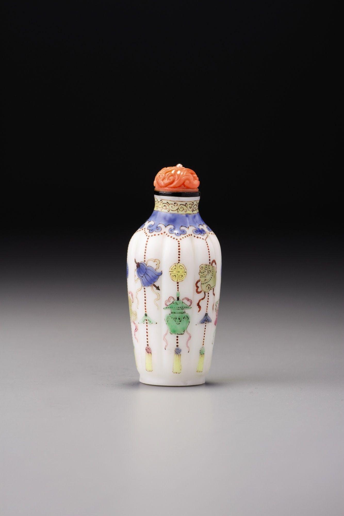 AN ENAMELLED WHITE GLASS 'EIGHT BUDDHIST EMBLEMS' SNUFF BOTTLE QING DYNASTY, QIANLONG PERIOD