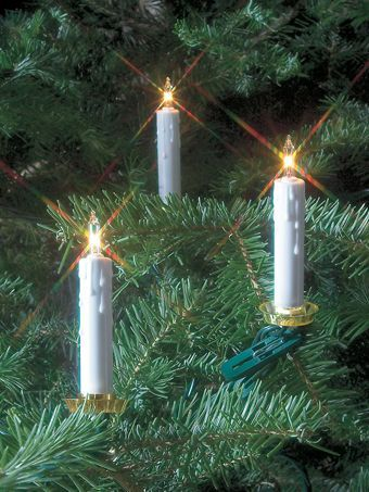 Clip-on Christmas tree candle lights for the look of an old-fashioned candle-lit  tree without the worry. Includes two replacement bulbs and fuses. - Clip-on Christmas Tree Candle Lights For The Look Of An Old