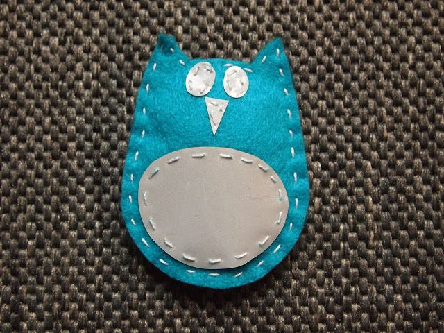 Made with love: Pöllöheijastin  owl reflector ----   accessories:   felt  Reflective fabric   Cotton wool   Needle and thread