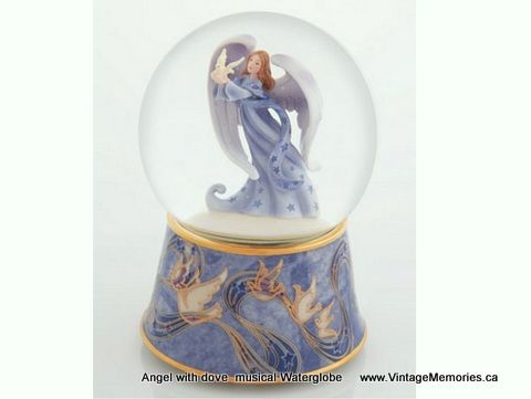 water globes   Frogs musical water globe (Tune: Singing in the Rain )