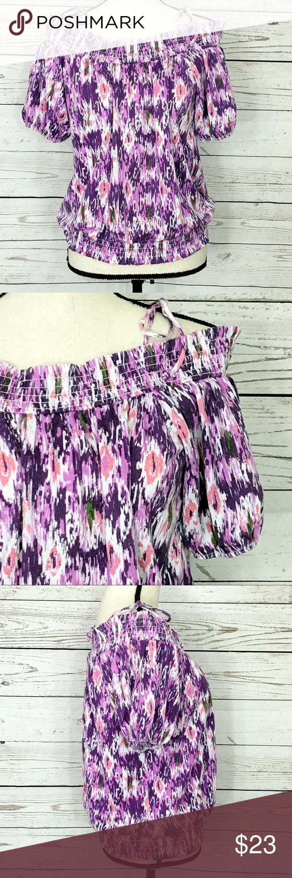 """Energie Purple Open Shoulder Tie Blouse Adorable purple, pink and white multicolored, abstract, loose blouse with off the shoulder short sleeves. It has ties at the top of the shoulder. There is elastic along the top, bottom of the blouse and the end of the sleeves. Bust: 36"""". Measurements are approximate. Smoke free home. 🌺Thanks for shopping my closet 😊🌺 Energie Tops Blouses"""