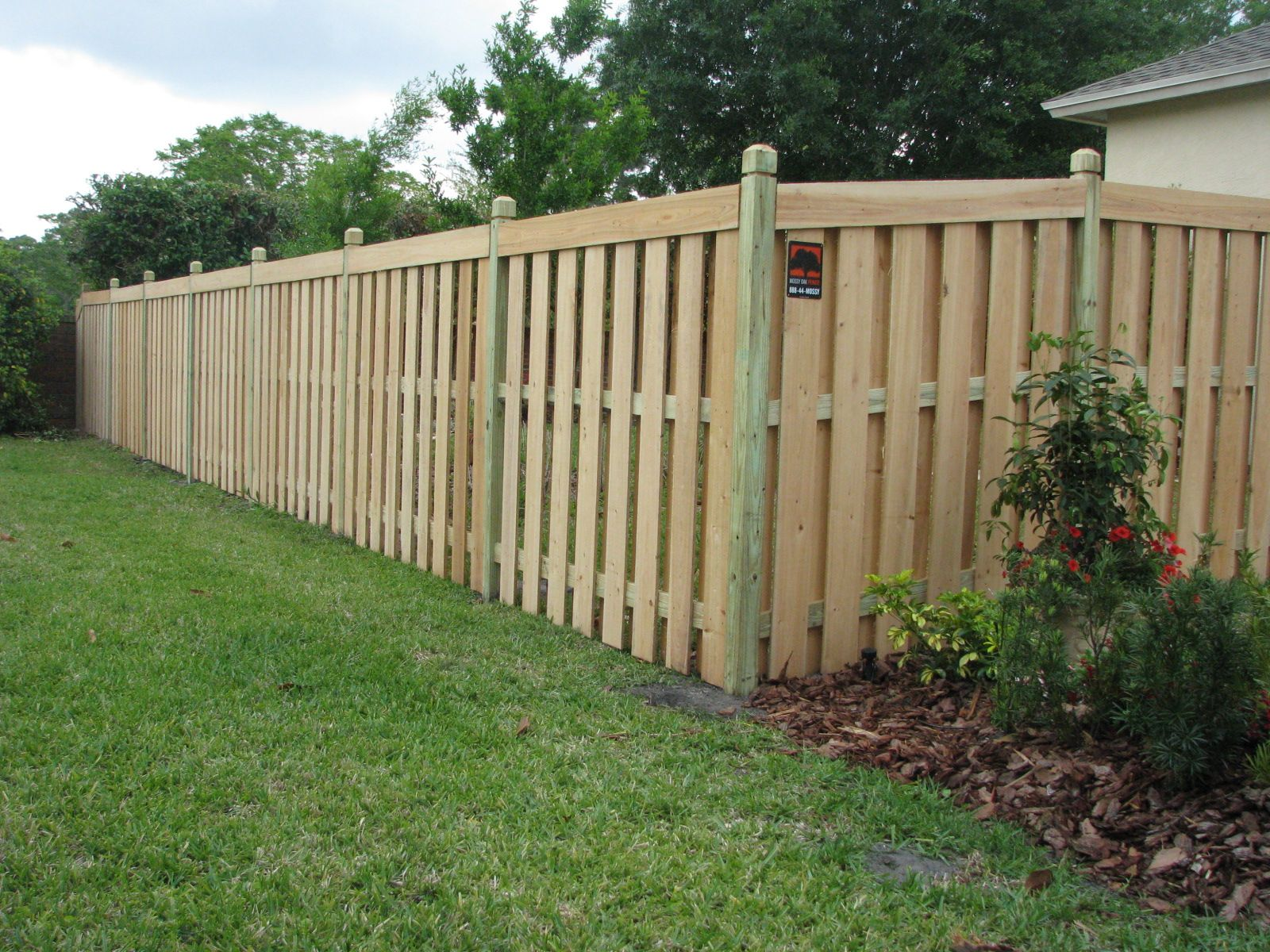 Capped Shadowbox Or Semi Privacy Wood Fence Mossy Oak Fence Company Orlando Melbourne Fl Fence Design Wood Fence Design Wood Fence