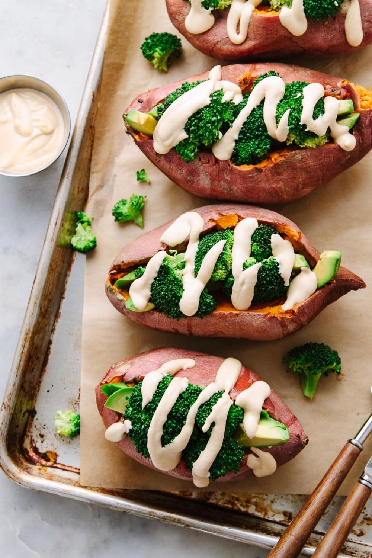 Vegan Stuffed Sweet Potatoes Recipe Features Tender Baked Sweet Potatoes Stuffed With Broccoli Avoc Vegan Sweet Potato Sweet Potato Recipes Whole Food Recipes