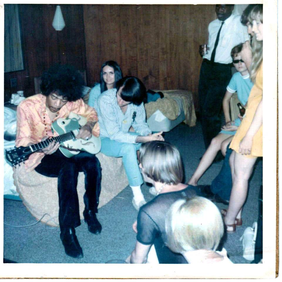 Jimi Hendrix and The Monkees: Michael Nesmith beside him, Peter Tork across from him, photo by Micky Dolenz.