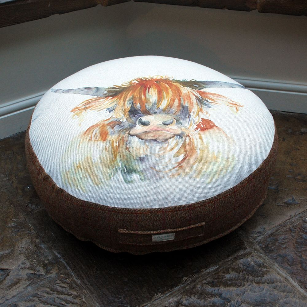 Highland Cow floor cushion by Voyage Maison now available at Curiosity Interiors in store & online at www.curiosityinteriors.co.uk
