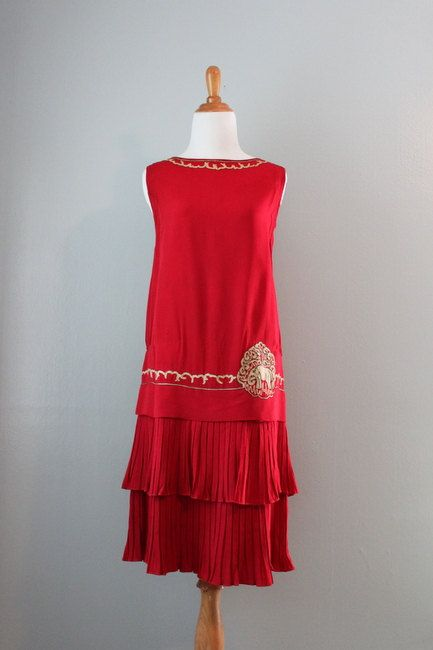 Dress: ca. 1920's, heavy silk crepe (possibly early rayon), trimmed with embroidery and metallic trim, bodice lined in silk.