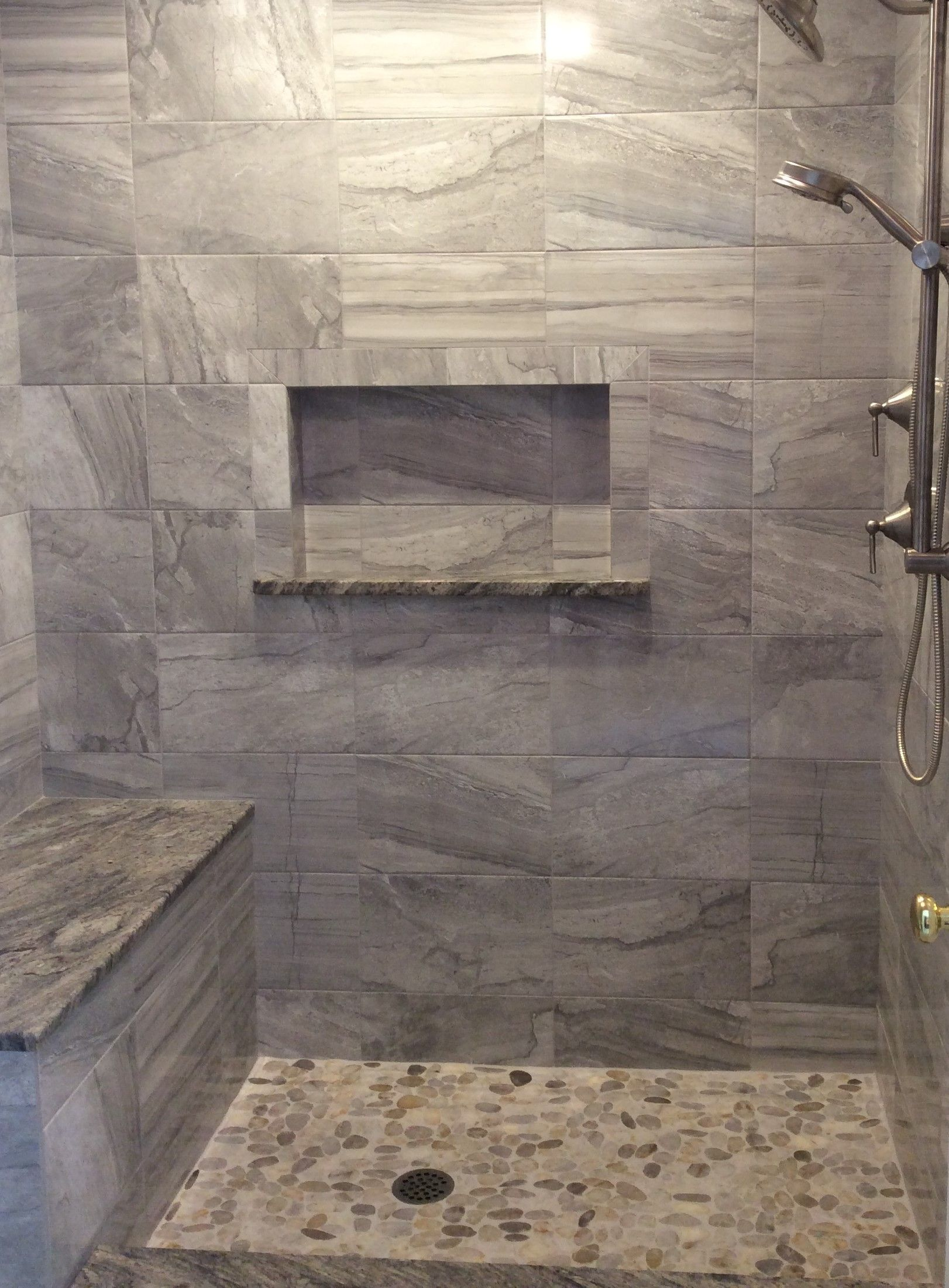Pebble rock shower floor and tile in greys and beige 12x24 give pebble rock shower floor and tile in greys and beige 12x24 give this shower a relaxing dailygadgetfo Choice Image
