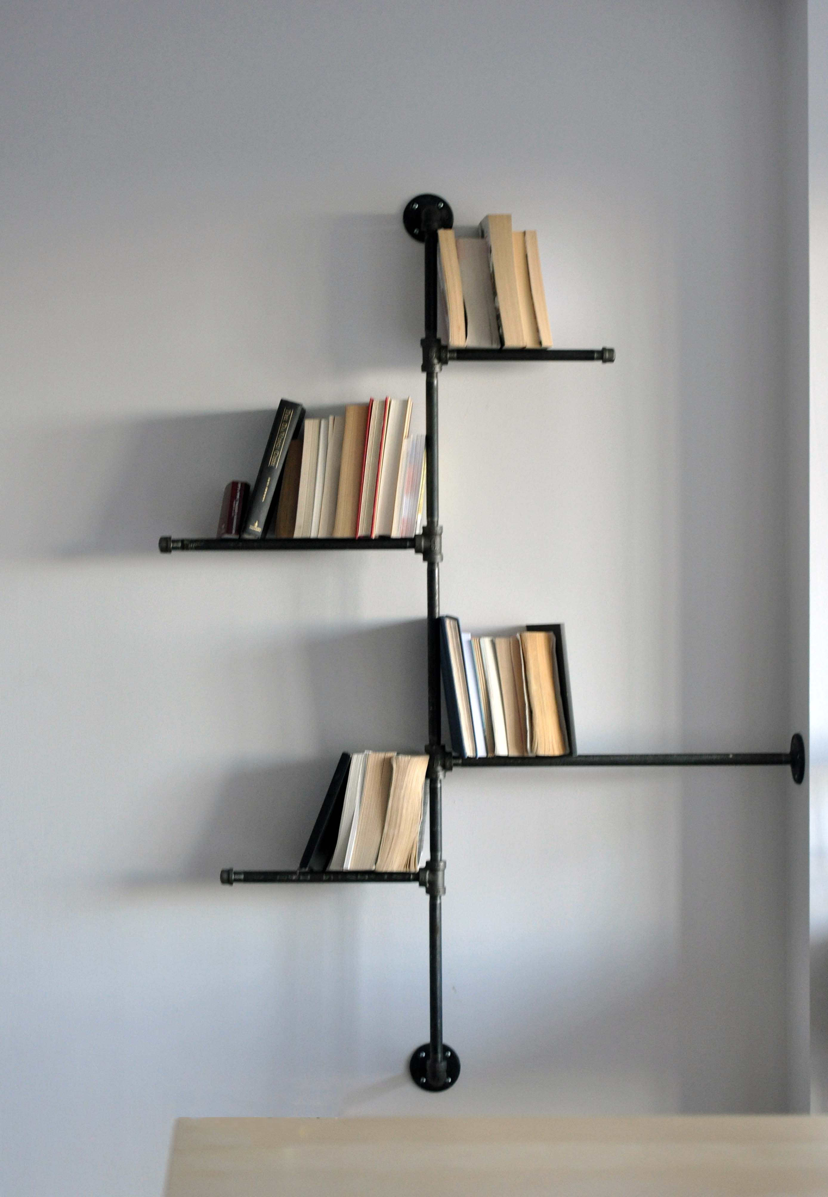 simple attractive lines in this metal bookshelf think the shelves are just metal rods though. Black Bedroom Furniture Sets. Home Design Ideas