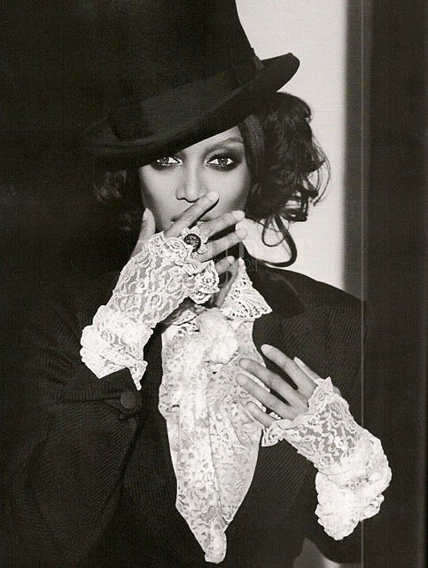 Lace gloves and a top hat.