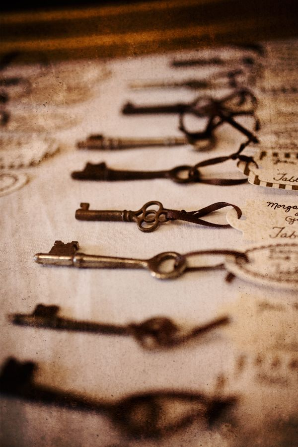Skeleton key place cards.  --I would adore going home from an event with a skeleton key....