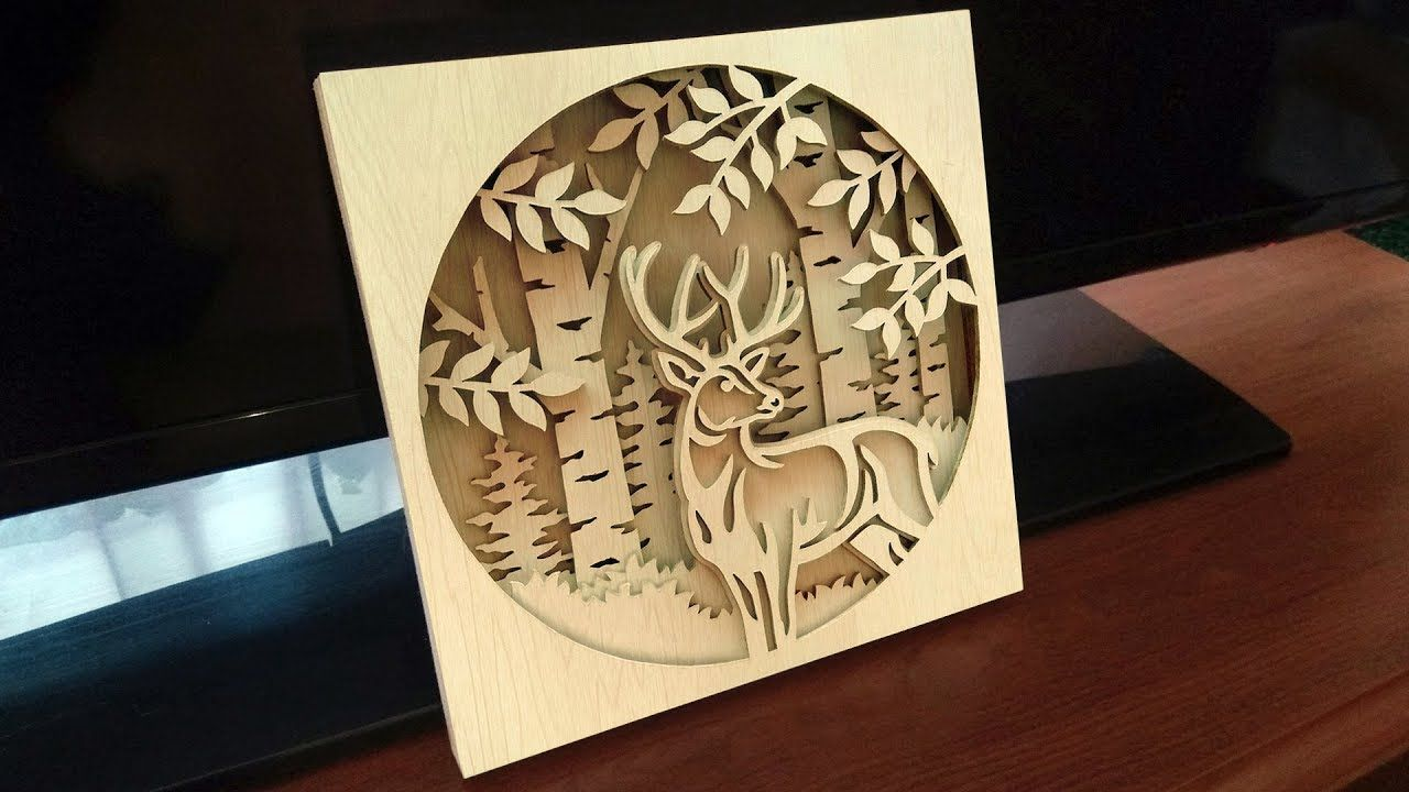 My first shadow box project deer scene scroll saw