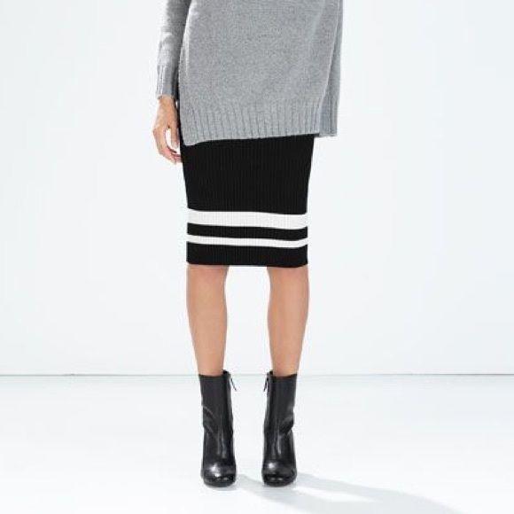28eb0e3b29 Zara Knit midi skirt with striped hem Zara Knit midi skirt with striped  hem. Ribbed stretchy knit material. New with tags, size medium. Zara Skirts  Midi